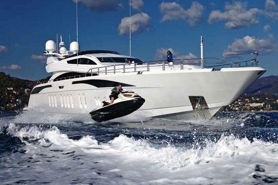 LISA IV charter yacht with guest on jetski