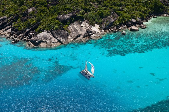 luxury catamaran anchored in a secluded bay on a Seychelles yacht charter