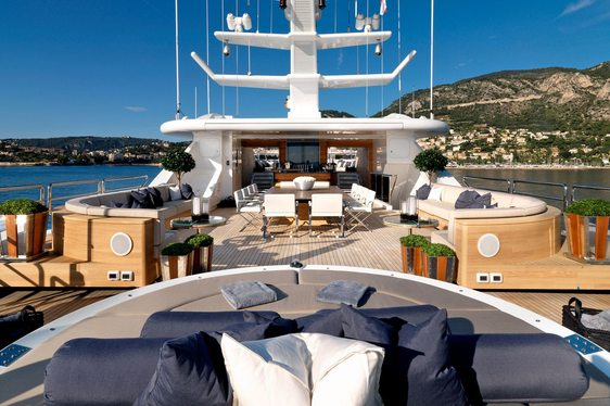 A dining table surrounded by sofa seating on board superyacht SEALYON