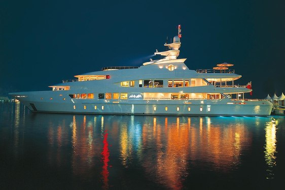 Lady Lola on charter in the Caribbean emitting multi-coloured lights from her hull