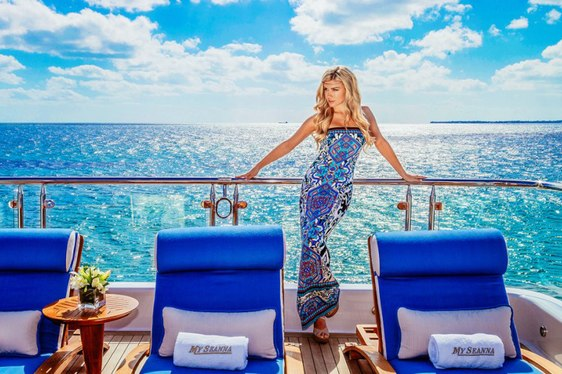 charter guest stands near sun loungers on the deck of superyacht 'My Seanna'