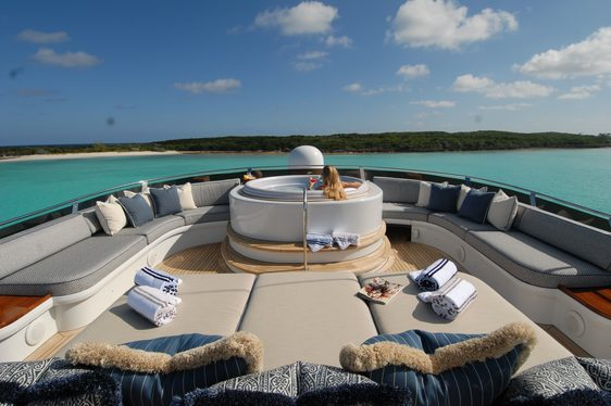 charter guest relaxes in the Jacuzzi on the sundeck of motor yacht 'Sweet Escape'