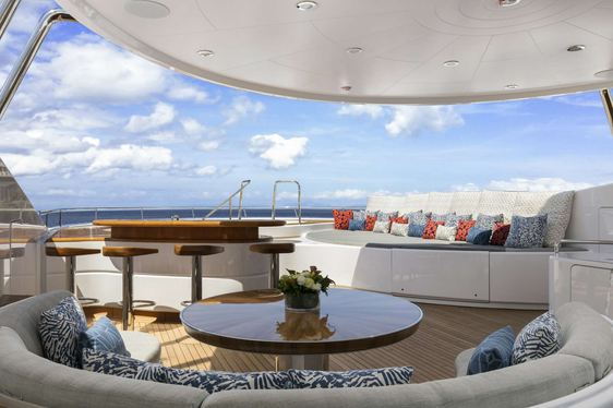 Jacuzzi, wet bar and seating on the sundeck of motor yacht BROADWATER