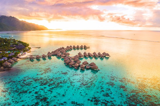 Overwater bungalows in Tahiti at sunset