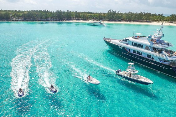 Aerial shot of luxury charter yacht M3 in the Bahamas with toys alongside her