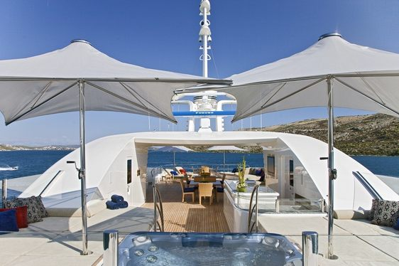 spa pool surrounded by sunpads on the sundeck of superyacht Mary-Jean II