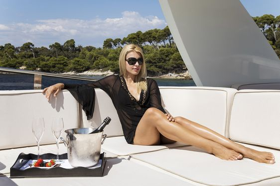 woman on board luxury yacht cappuccino with champagne