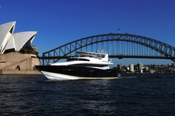 Superyacht Patriot on charter in sydney harbour with opera house in backgrounf