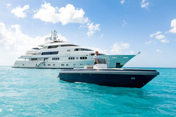 motor yacht TITANIA cruising on a charter vacation alongside the tender