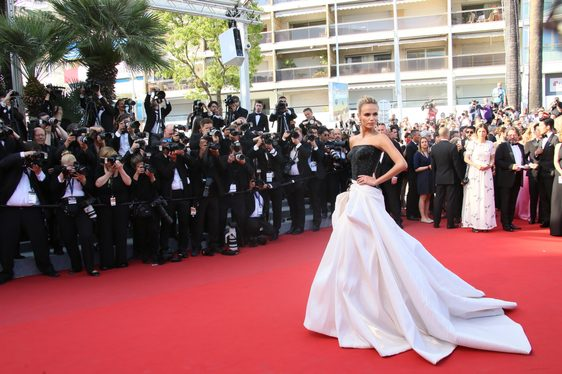 model walks along the red carpet at the Palais des Festivals for a screening at the Cannes Film Festival