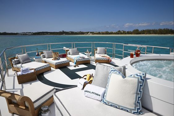 Sun loungers and Jacuzzi on helipad of superyacht Highlander