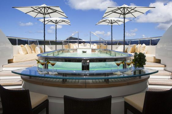 inviting pool with swim-up bar on the sundeck aboard charter yacht ROMA