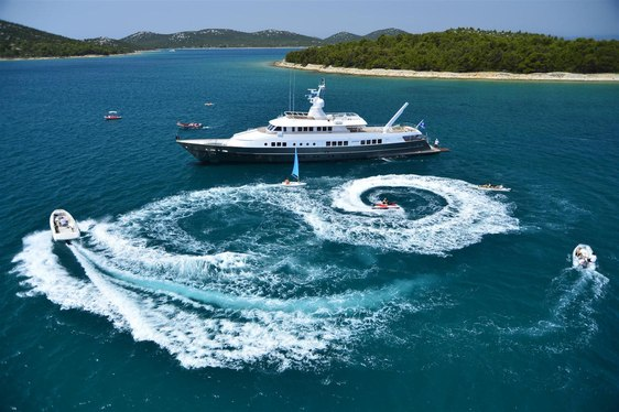 superyacht BERZINC anchors on a yacht charter surrounded by water toys