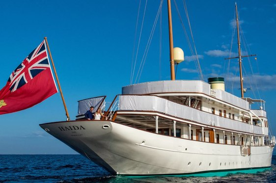 Charter guests on the bow of luxury superyacht Haida 1929