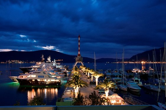 Superyachts in Porto Montenegro harbour at night