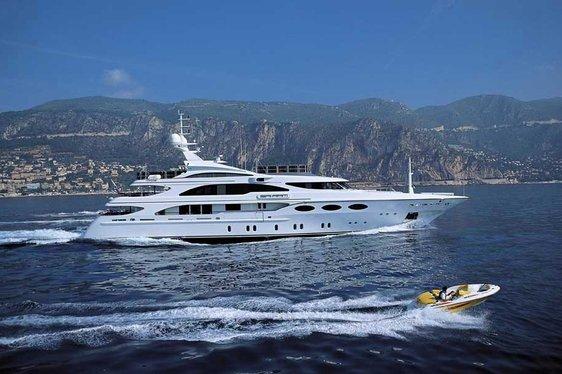 Superyacht Sai Rai cruising in the Caribbean on charter beside tender