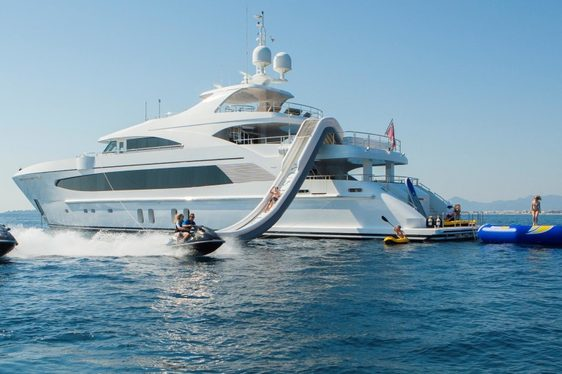 superyacht Big Sky anchors on a Bahamas yacht charter alongside her water toys