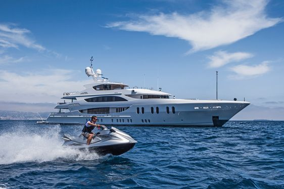 superyacht LIBERTY anchors on a Caribbean yacht charter as guests try out the jet skis