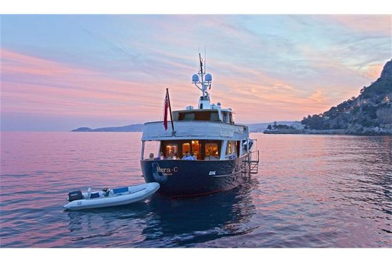 Rear view of charter yacht Hera C at dusk in the Mediterranean