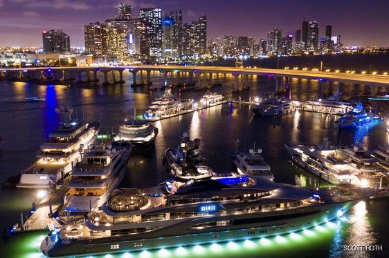 Lurssen superyacht KISMET lit up at night at Island Gardens Deep