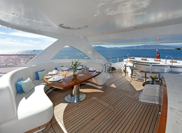 alfresco dining area with spa pool beyond on the sundeck of motor yacht SOLIS