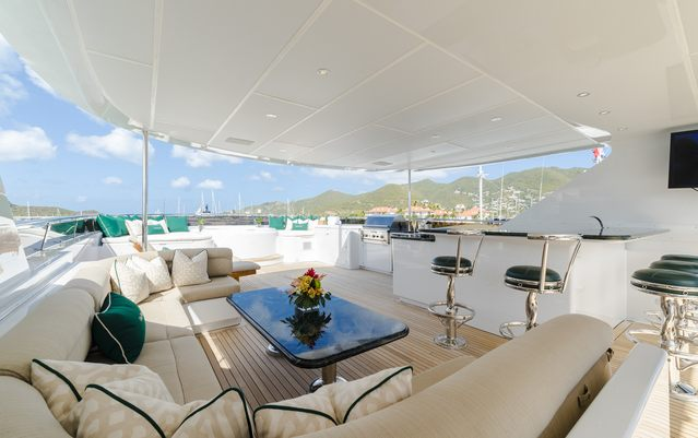 bar and seating area under the radar arch on the sundeck of superyacht One More Toy