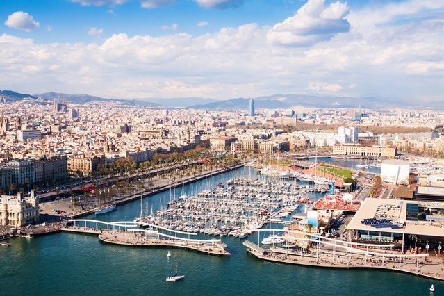 Aerial view of Barcelona city with Port Vell in cloudy day.Spain