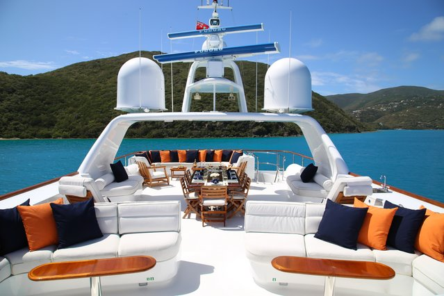 sundeck with seating areas and dining table on board luxury yacht M4