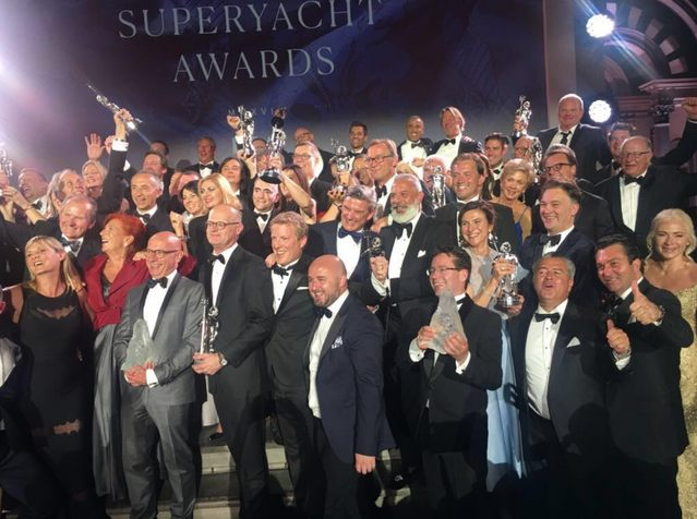winners at the World Superyacht Awards 2018 gather on the stage with their Neptune trophies