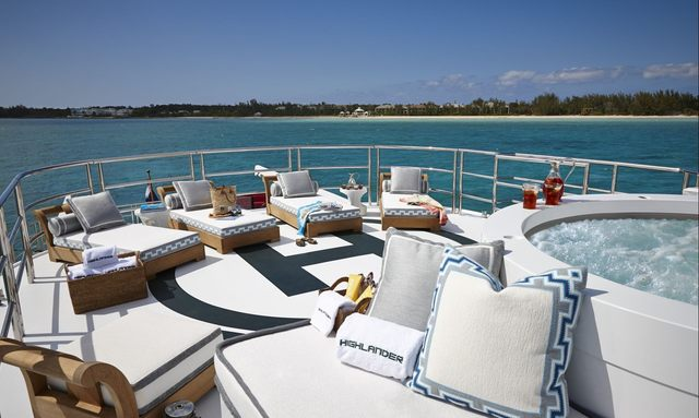 Sun loungers and Jacuzzi on helipad of superyacht Highlander