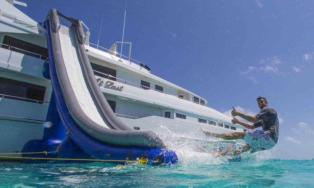 man goes down slide of luxury charter yacht at last from heesen