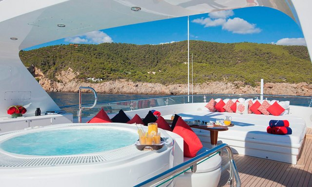 Sundeck on luxury yacht Big Change II, with spa pool and sunpads