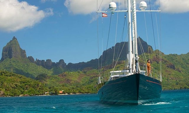 Sailing yacht BLISS on charter with mountains in background