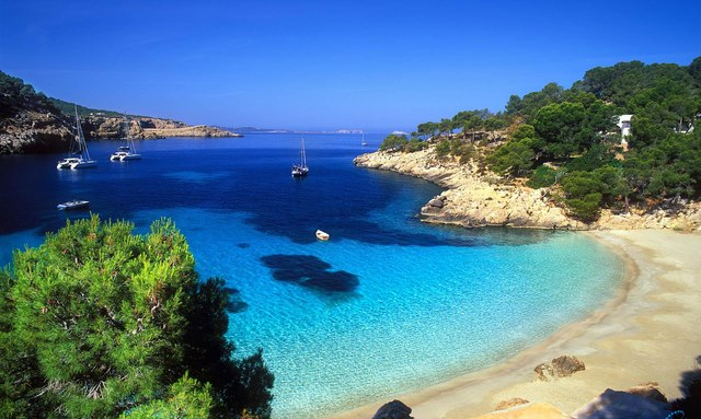 Superyacht at anchor in beautiful waters of Balearic Islands
