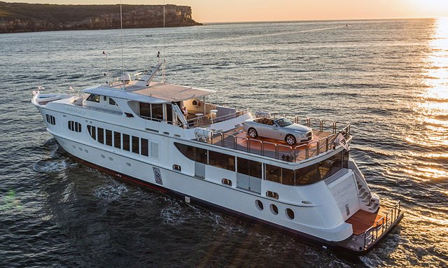 Superyacht TANGO sails into Sydney harbour with new rolls-royce on top deck