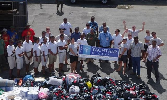 'The YachtAid Global Team delivering aid to Fiji after damage destruction from Cyclone Evan in December 2012