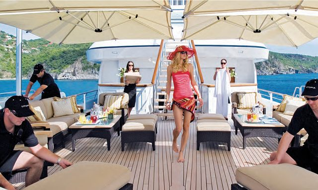 Charter guest on sundeck of luxury yacht UTOPIA