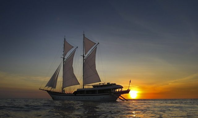 New charter yacht Zen at anchor in Indonesia at sunset