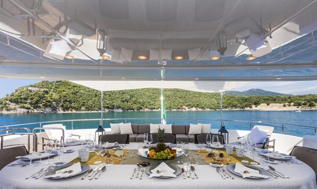 AL fresco dining area on motor yacht for charter Ferdy