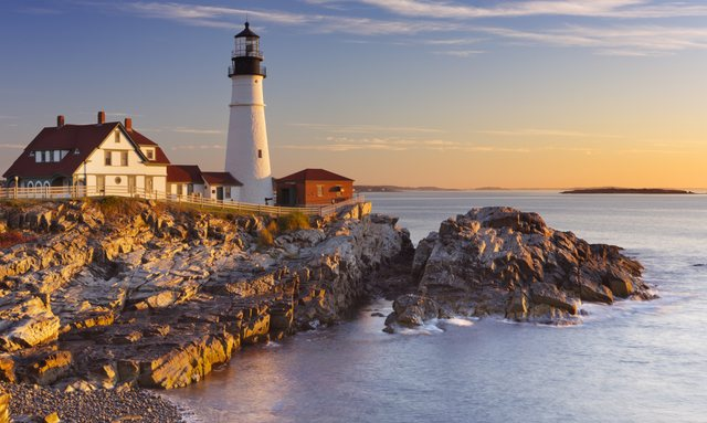 Lighthouse on the rocky coast of New England, overlooking the ocean