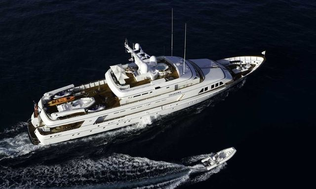 Aerial shot of charter yacht Charisma with one of her tenders