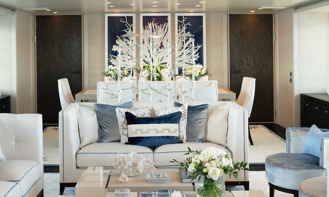 luxury yacht SPIRIT main salon, with blue artwork and formal dining