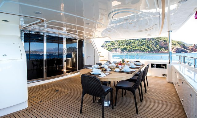 Alfresco dining table set for dinner on board superyacht Robusto on charter in French Riviera