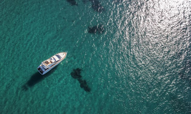Yacht viewed from above on clear Caribbean water