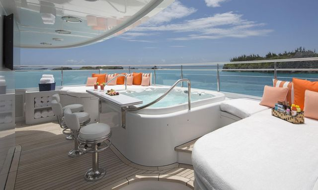 spa pool with swim-up bar on the forward section of the sundeck aboard motor yacht Time For Us