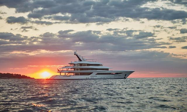 luxury yacht joy profile shot with sunset in background
