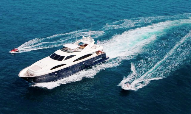 Aeriel view of motor yacht Celtic Dawn cruising with water toys