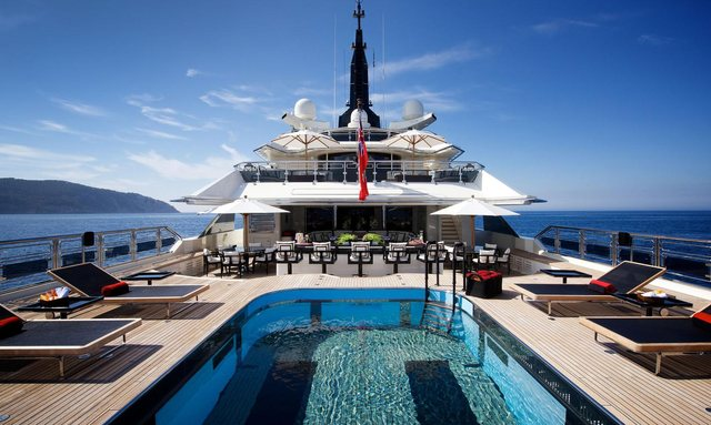 pool, loungers and bar on the main deck aft of luxury yacht Alfa Nero