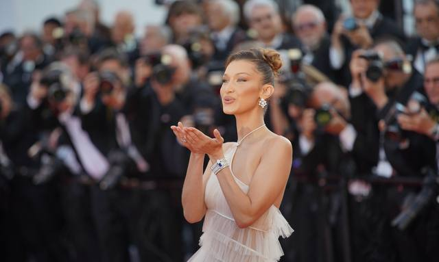 Supermodel Bella Hadid blows kiss on red carpet during Cannes Film Festival 2019