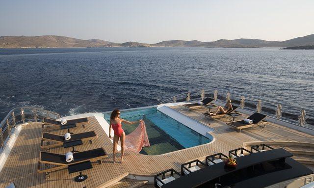 superyacht ALFA NERO infinity pool with women reclining nearby